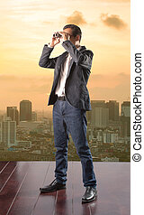 business man looking to future opportunity by binocular and...