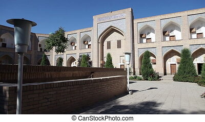 courtyard of ancient madrasah. Uzbekistan. Khiva - courtyard...