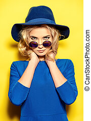 stylish girl - Pretty girl with curly blonde hair wearing...
