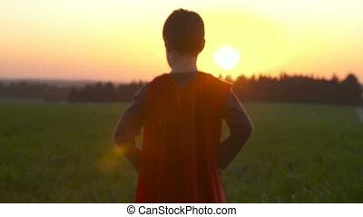 Boy in a superman cape - Boy dressed in a superman cape runs...