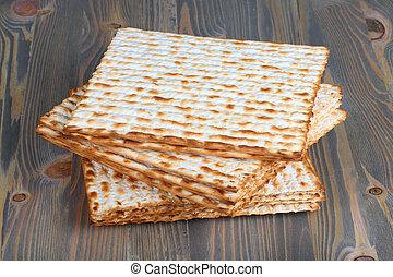 Matzah on wooden table - Closeup of Matzah on wooden table...
