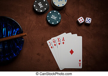 Poker chips and generic playing cards. Courts for poker...