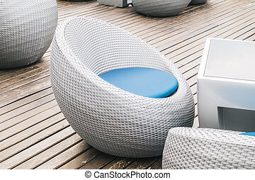 Empty chair and table with outdoor deck