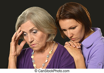sad Senior woman with daughter - Portrait of sad Senior...