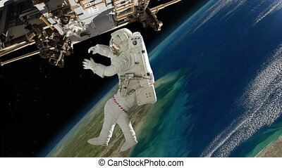 Astronaut spacewalk on station above the Earth