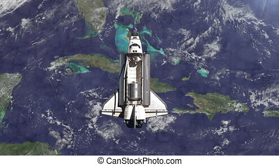 The Space Shuttle above the Earth.