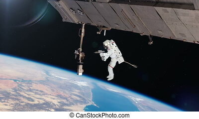 Astronaut Working On International Space Station Elements of...