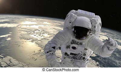 Astronaut in space above the Earth Elements of this image...