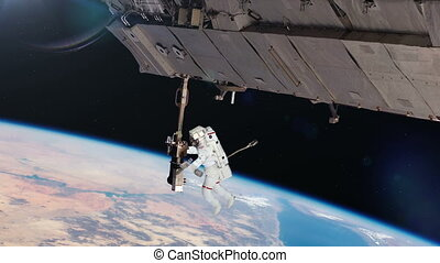 Astronaut working on space station - Astronaut Working On...