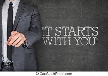 It starts with you son blackboard with businessman - It...