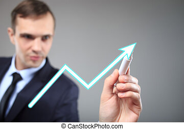 Businessman highlighting business growth on a graph. profit