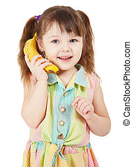 Child uses a banana as a mobile phone isolated on white