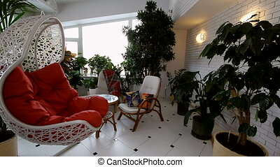 Red Rocking Chair in Luxury Apartment Interior. Showcase of...