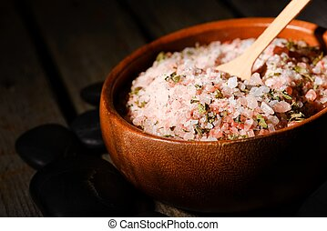 Pink sea salt with herbs in bowl