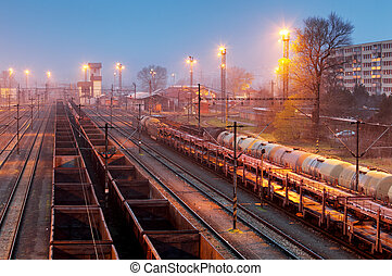 Cargo freigt train railroad station at dusk