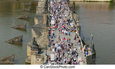 """prague castle view, people walking crossing charles bridge,..."