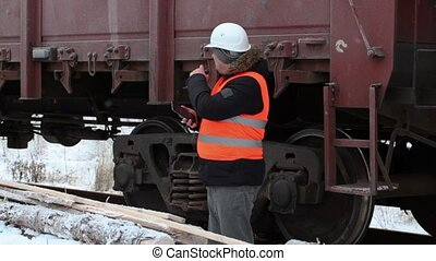 Railway officer numbering freight wagons