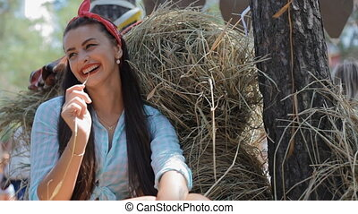 Woman laught sitting on the haystack - Young white woman...