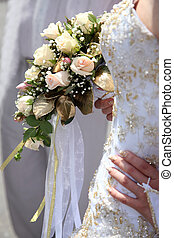 wedding bouquet of roses in hand the bride