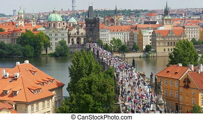 quot;prague castle view, people walking crossing charles...