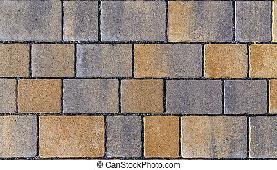 Paving blocks made of square stone in bright ligh - red...