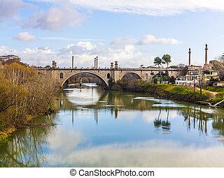 old bridge spans river tiber in rome