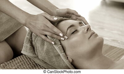 Facial massage - Woman getting facial massage in spa