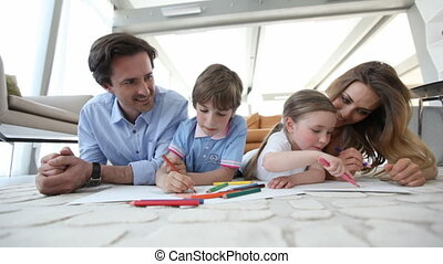 Parents drawing with children - Happy parents drawing with...