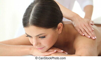 Young woman being massaged in spa salon