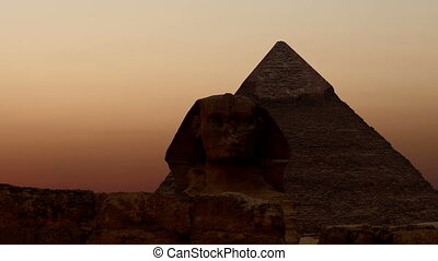 Sunrise over the pyramid of Cheops - Timelapse. Sunrise over...