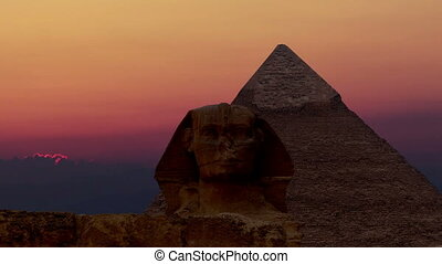 Timelapse. Sunrise over the pyramid of Cheops and Sphinx....