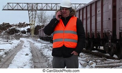 Railway officer using smartphone