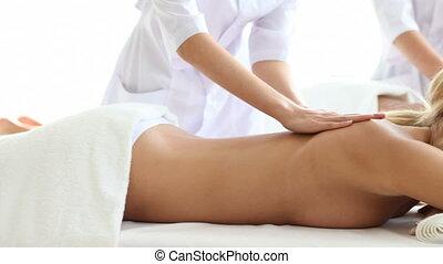 Two women getting massage in spa salon