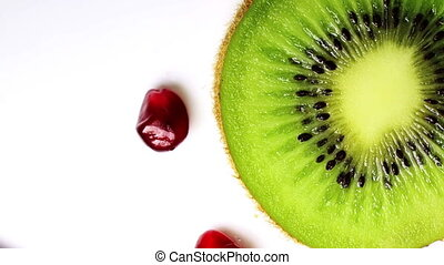 Kiwi slice and pomegranate seeds, close-up