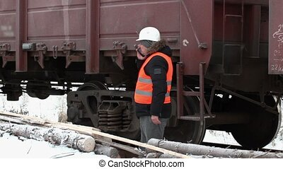 Engineer check the freight wagons