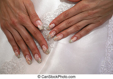 the bride shows her manicured hand