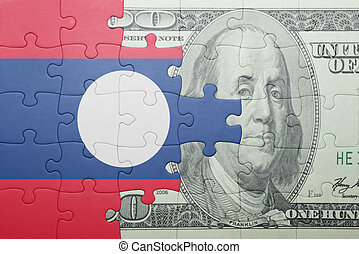 puzzle with the national flag of laos and dollar banknote