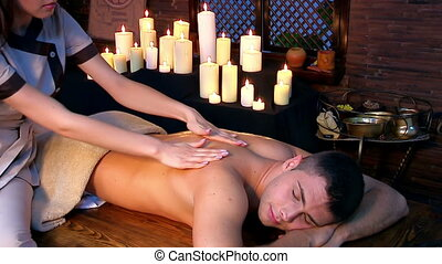 Man having Ayurvedic spa treatment - Young man having oil...