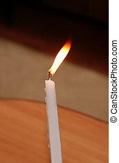 one white burning candle