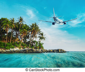 Airplane flying over tropical ocean landscape Thailand...