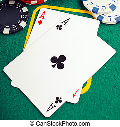 poker two aces - Stack of chips and two aces on the table on...