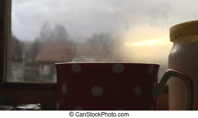 Close up view of hot steam vapour from coffee drink. - Close...