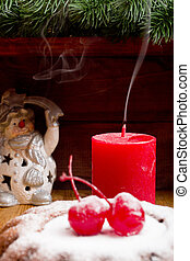 Christmas candle extinguished with the remnants of smoke and...