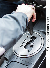 Hand on automatic gear shift,
