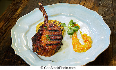 Dry Aged Barbecue Tomahawk Steak with polenta
