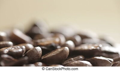 """Shot of Fresh coffee beans rotation - """"100%, advertise,..."""