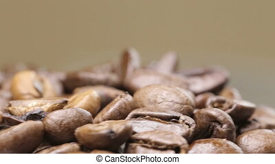 Shot of Frsesh roasted coffee beans rotation with copyspace...