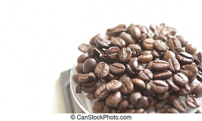 Shot of Rotating fresh coffee beans with white copy space