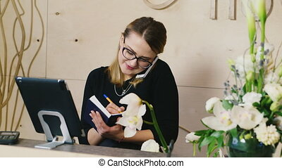Young woman working in office Flower delivery service