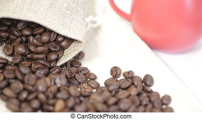 Shot of coffee beans spread on bright surface - 100,...